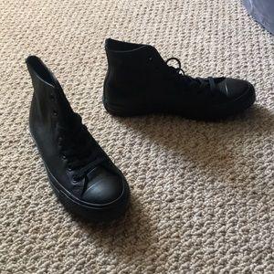 Black high top converse basketball shoe